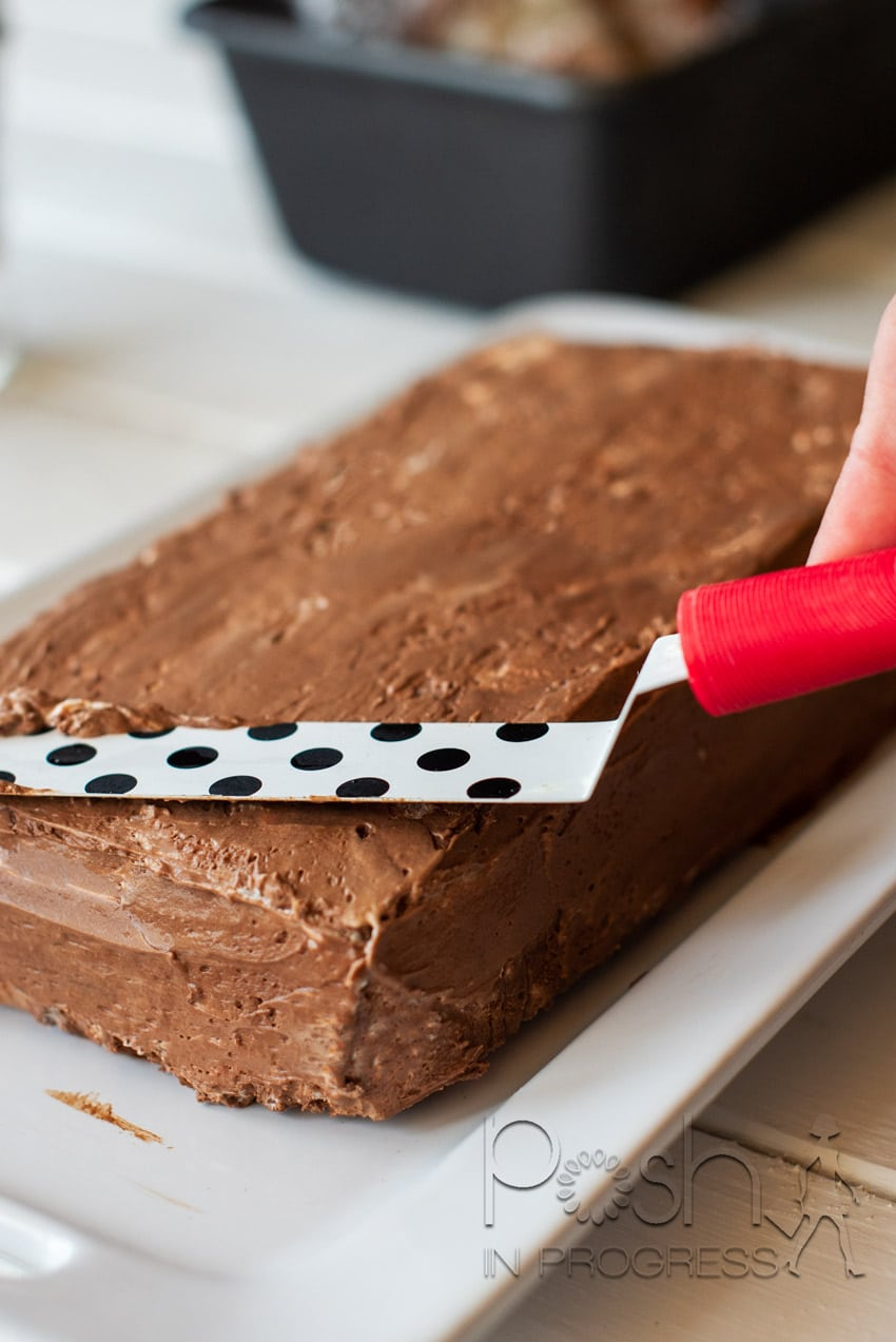 You may find that your chocolate semifreddo isn't as picture perfect as you might like. Here's a pro tip: dip an offset spatula in water and smooth out your chocolate semifreddo.
