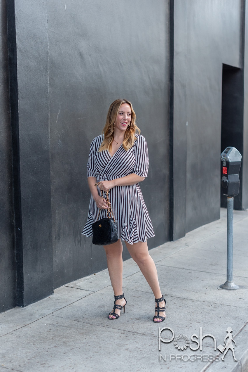 black and white striped dress 3 |  Black and White Dresses by popular LA fashion blog, Posh in Progress: image of a woman standing in front of a black building and wearing a black and white stripe dress with black heel sandals.