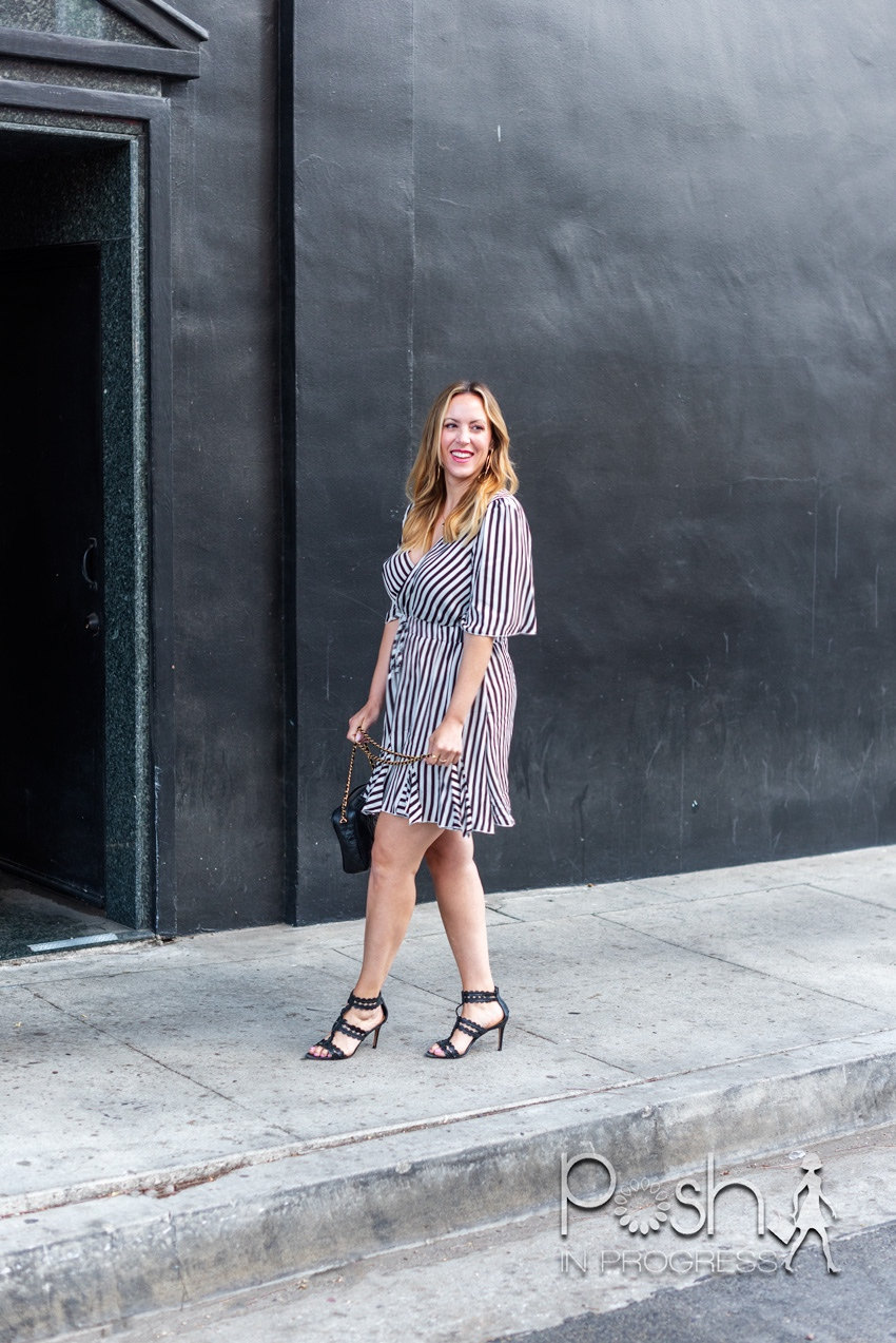 black and white striped dress | Black and White Dresses by popular LA fashion blog, Posh in Progress: image of a woman standing in front of a black building and wearing a black and white stripe dress with black heel sandals.