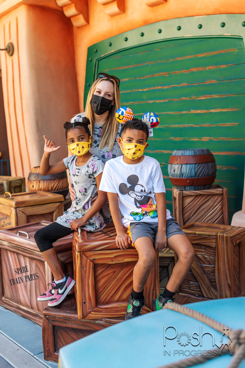 Disneyland Reopening by popular LA lifestyle blog, Posh in Progress: image of a mom and her two kids at the Disneyland Roger Rabbit ride and wearing Mickey Mouse and Minnie Mouse clothing.
