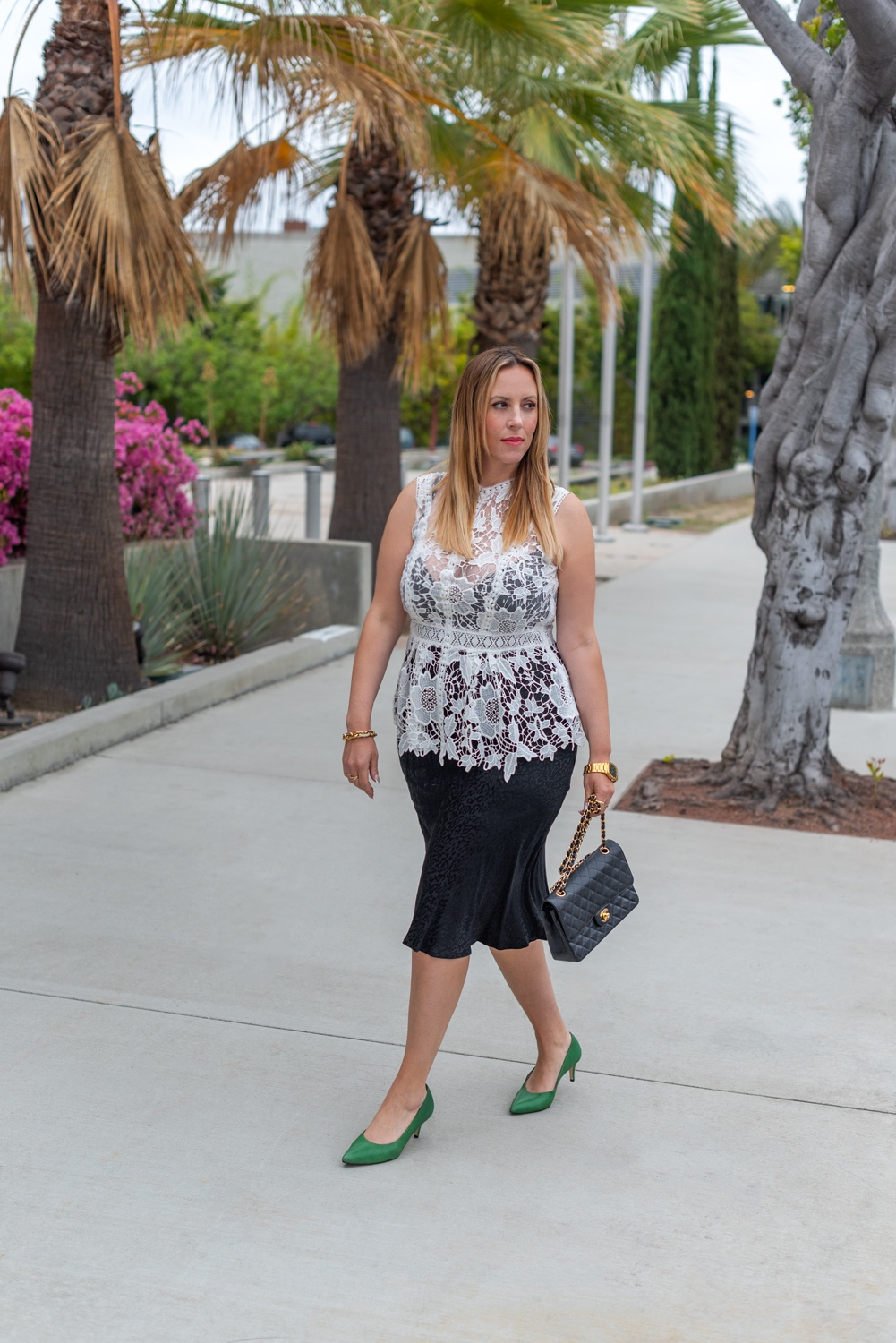 what to wear from work to happy hour | What to Wear by popular LA fashion blog, Posh in Progress: image of a woman wearing a white lace top, black skirt gold watch, gold link bracelet, green heels, and black quilted Chanel bag.