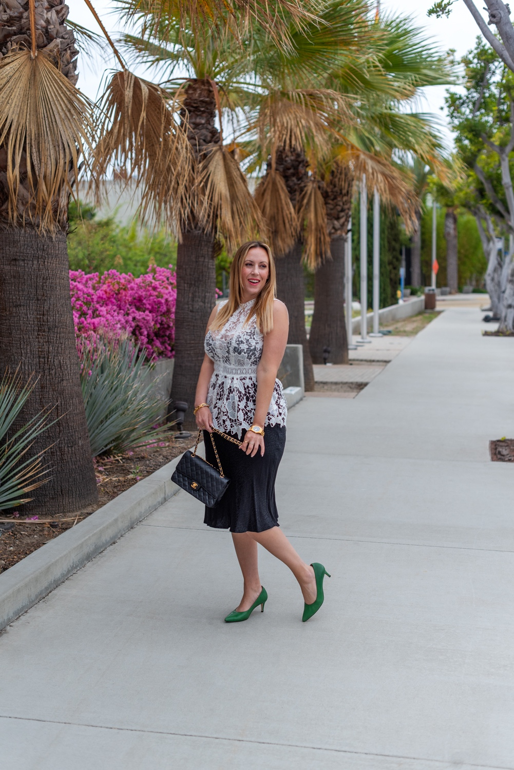wear from work to happy hour 3 | What to Wear by popular LA fashion blog, Posh in Progress: image of a woman wearing a white lace top, black skirt gold watch, gold link bracelet, green heels, and black quilted Chanel bag.