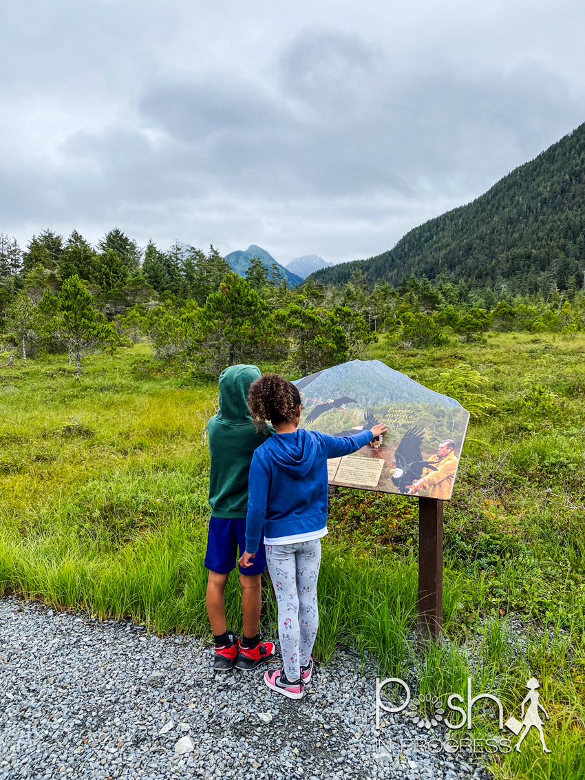 things to do in sitka 2 | Things to do in Sitka Alaska by popular LA travel blog, Posh in Progress: image of a young boy and girl looking at an informational sign at the Alaska Raptor Center.